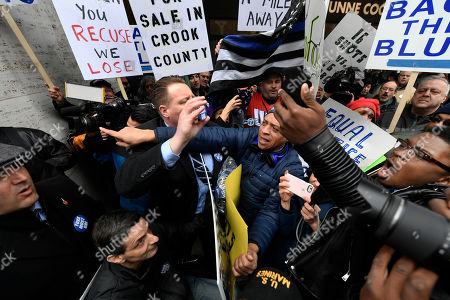 "Stock Photo of Dueling protestors clash over Cook County State's Attorney Kim Foxx's office's decision to drop all charges against ""Empire"" actor Jussie Smollett, in Chicago"