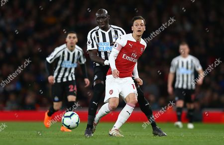 Mesut Ozil of Arsenal and  Mohamed Diame of Newcastle