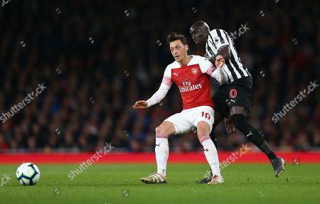 Mesut Ozil of Arsenal battles with  Mohamed Diame of Newcastle