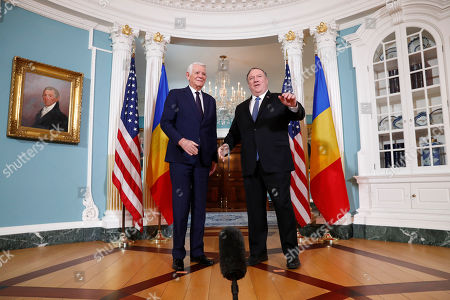 Mike Pompeo, Teodor Melescanu. Secretary of State Mike Pompeo, right, waves as he turns to leave with Romanian Foreign Minister Teodor Melescanu at the State Department, in Washington