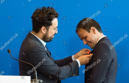Mounir Mahjoubi gives the red rooster (French Tech) to French Junior Economy Minister in Charge of Digita, Cedric O.