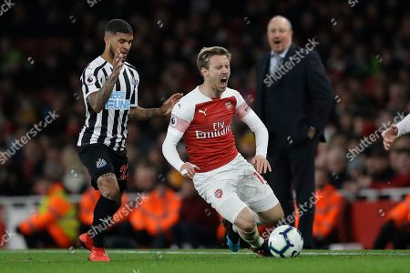 Newcastle's DeAndre Yedlin, left, competes for the ball with Arsenal's Nacho Monreal watched by Newcastle's manager Rafael Benitez during the English Premier League soccer match between Arsenal and Newcastle United at Emirates stadium in London
