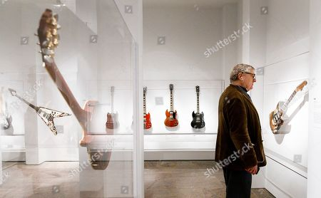 Man looks at a guitar (R) played by Stevie Ray Vaughn during a preview of the new exhibit 'Play It Loud: Instruments of Rock & Roll' at the Metropolitan Museum of Art in New York, New York, USA, 01 April 2019. The exhibit features over 130 musical instruments, including many electric guitars, from iconic rock and roll musicians dating from 1939 to 2017 including The Beatles, Chuck Berry, Jimmy Page, Elvis Presley, and Jimi Hendrix. It runs from 08 April 2019 until 01 October 2019.