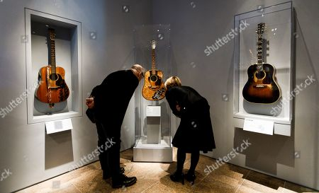 Two people look at guitars owned by Buddy Holly (C) with guitars owned by Wanda Jackson (L) and Don Everly (R) during a preview of the new exhibit 'Play It Loud: Instruments of Rock & Roll' at the Metropolitan Museum of Art in New York, New York, USA, 01 April 2019. The exhibit features over 130 musical instruments, including many electric guitars, from iconic rock and roll musicians dating from 1939 to 2017 including The Beatles, Chuck Berry, Jimmy Page, Elvis Presley, and Jimi Hendrix. It runs from 08 April 2019 until 01 October 2019.