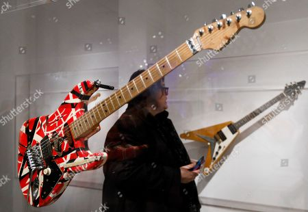 Eddie Van Halen's 'Frankenstien' guitar (L) is seen during a preview of the new exhibit 'Play It Loud: Instruments of Rock & Roll' at the Metropolitan Museum of Art in New York, New York, USA, 01 April 2019. The exhibit features over 130 musical instruments, including many electric guitars, from iconic rock and roll musicians dating from 1939 to 2017 including The Beatles, Chuck Berry, Jimmy Page, Elvis Presley, and Jimi Hendrix. It runs from 08 April 2019 until 01 October 2019.