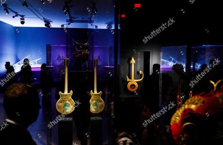 People look at guitars played by Steve Miller (L) and Prince (R) as well as a piano played by Lady Gaga (background L) during a preview of the new exhibit 'Play It Loud: Instruments of Rock & Roll' at the Metropolitan Museum of Art in New York, New York, USA, 01 April 2019. The exhibit features over 130 musical instruments, including many electric guitars, from iconic rock and roll musicians dating from 1939 to 2017 including The Beatles, Chuck Berry, Jimmy Page, Elvis Presley, and Jimi Hendrix. It runs from 08 April 2019 until 01 October 2019.