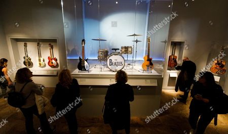 People look at Ringo Starr's drum kit during a preview of the new exhibit 'Play It Loud: Instruments of Rock & Roll' at the Metropolitan Museum of Art in New York, New York, USA, 01 April 2019. The exhibit features over 130 musical instruments, including many electric guitars, from iconic rock and roll musicians dating from 1939 to 2017 including The Beatles, Chuck Berry, Jimmy Page, Elvis Presley, and Jimi Hendrix. It runs from 08 April 2019 until 01 October 2019.