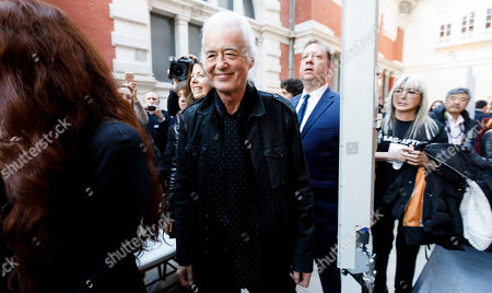 Guitarist Jimmy Page (C) is seen during a press conference for the new exhibit 'Play It Loud: Instruments of Rock & Roll' at the Metropolitan Museum of Art in New York, New York, USA, 01 April 2019. The exhibit features over 130 musical instruments, including many electric guitars, from iconic rock and roll musicians dating from 1939 to 2017 including The Beatles, Chuck Berry, Jimmy Page, Elvis Presley, and Jimi Hendrix. It runs from 08 April 2019 until 01 October 2019.