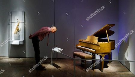 A man looks at a piano played by Jerry Lee Lewis during a preview of the new exhibit 'Play It Loud: Instruments of Rock & Roll' at the Metropolitan Museum of Art in New York, New York, USA, 01 April 2019. The exhibit features over 130 musical instruments, including many electric guitars, from iconic rock and roll musicians dating from 1939 to 2017 including The Beatles, Chuck Berry, Jimmy Page, Elvis Presley, and Jimi Hendrix. It runs from 08 April 2019 until 01 October 2019.