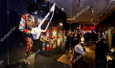A guitar and outfit owned by Prince is seen during a preview of the new exhibit 'Play It Loud: Instruments of Rock & Roll' at the Metropolitan Museum of Art in New York, New York, USA, 01 April 2019. The exhibit features over 130 musical instruments, including many electric guitars, from iconic rock and roll musicians dating from 1939 to 2017 including The Beatles, Chuck Berry, Jimmy Page, Elvis Presley, and Jimi Hendrix. It runs from 08 April 2019 until 01 October 2019.