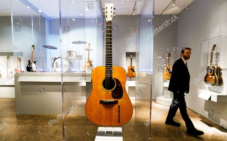 A guitar played by Elvis Presley (C) and Ringo Starr's drum kit (L) are seen during a preview of the new exhibit 'Play It Loud: Instruments of Rock & Roll' at the Metropolitan Museum of Art in New York, New York, USA, 01 April 2019. The exhibit features over 130 musical instruments, including many electric guitars, from iconic rock and roll musicians dating from 1939 to 2017 including The Beatles, Chuck Berry, Jimmy Page, Elvis Presley, and Jimi Hendrix. It runs from 08 April 2019 until 01 October 2019.
