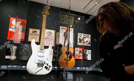 A woman looks at guitars played by Jimi Hendrix (L) and  (C) and Eric Clapton (C) during a preview of the new exhibit 'Play It Loud: Instruments of Rock & Roll' at the Metropolitan Museum of Art in New York, New York, USA, 01 April 2019. The exhibit features over 130 musical instruments, including many electric guitars, from iconic rock and roll musicians dating from 1939 to 2017 including The Beatles, Chuck Berry, Jimmy Page, Elvis Presley, and Jimi Hendrix. It runs from 08 April 2019 until 01 October 2019.