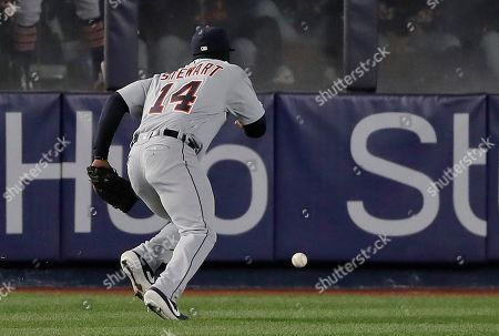 Detroit Tigers left fielder Christin Stewart (14) chases down the ball after committing a fielding error on a ball hit by New York Yankees' Greg Bird allowing a run to score during the third inning of a baseball game, in New York