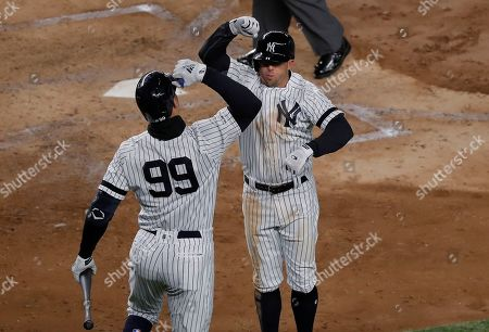 New York Yankees' Brett Gardner, right, celebrates with Aaron Judge (99) after hitting a solo home run against the Detroit Tigers during the fifth inning of a baseball game, in New York