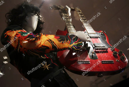"""A double-neck guitar played by Jimmy Page of Led Zeppelin is displayed at the exhibit """"Play It Loud: Instruments of Rock & Roll,"""" at the Metropolitan Museum of Art in New York, . The exhibit, which showcases the instruments of rock and roll legends, opens to the public on April 8 and runs until Oct. 1, 2019"""