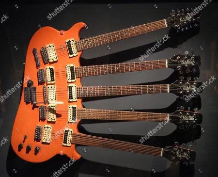 """A five-neck guitar used by Rick Nielsen of Cheap Trick is displayed at the exhibit """"Play It Loud: Instruments of Rock & Roll,"""" at the Metropolitan Museum of Art in New York, . The exhibit, which showcases the instruments of rock and roll legends, opens to the public on April 8 and runs until Oct. 1, 2019"""