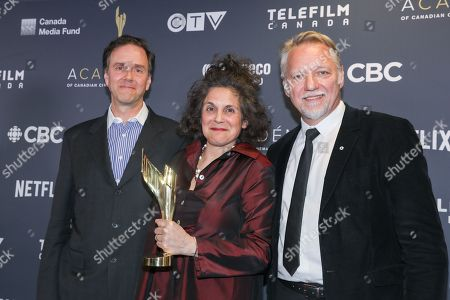 "Jennifer Baichwal, Nicholas de Pencier, Edward Burtynsky. Winner of Ted Rogers Best Feature Length Documentary for ""Anthropocene: The Human Epoch""."