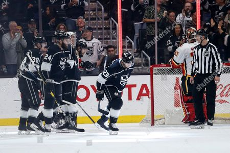 Los Angeles Kings forward Dustin Brown (23) celebrates his goal against Calgary Flames during the first period of an NHL hockey game, in Los Angeles