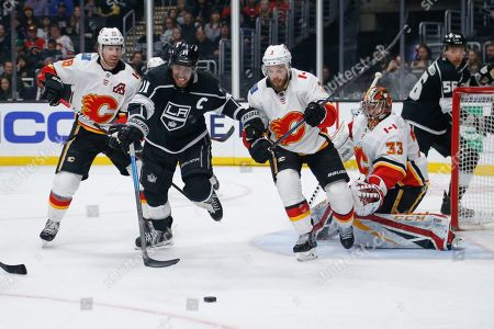 Calgary Flames goalie David Rittich (33) protects the net as defenseman Oscar Fantenberg (3) and James Neal (18) vie with Los Angeles Kings forward Anze Kopitar (11) during the second period of an NHL hockey game, in Los Angeles
