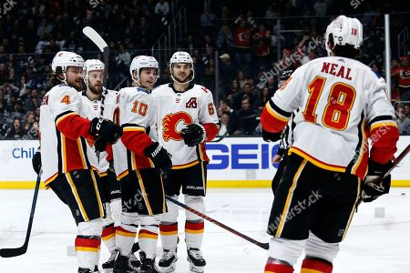 Calgary Flames forward Derek Ryan (10) celebrates his goal with teammates against the Los Angeles Kings during the third period of an NHL hockey game, in Los Angeles. Flames won 7-2