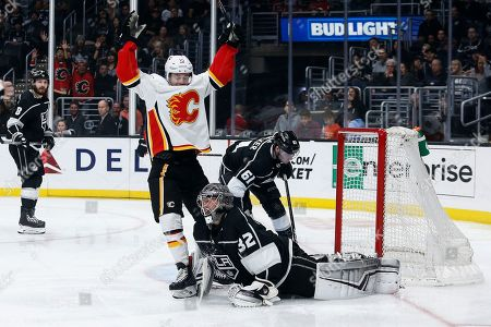 Calgary Flames forward Derek Ryan (10) celebrates after scoring on Los Angeles Kings goalie Jonathan Quick (32) during the third period of an NHL hockey game, in Los Angeles. Flames won 7-2