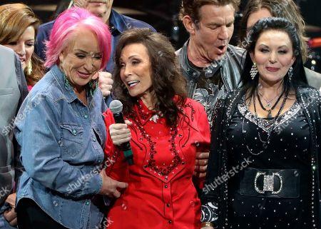 Stock Picture of Tanya Tucker, Loretta Lynn and Crystal Gayle perform at Loretta Lynn's 87th Birthday Tribute at Bridgestone Arena, in Nashville, Tenn