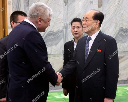 Stock Photo of Kim Yong Nam, right, president of the Presidium of the Supreme People's Assembly of North Korea, meets with Russian Interior Affairs Minister Vladimir Kolokoltsev at the Mansudae Assembly Hall in Pyongyang, North Korea