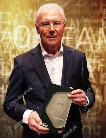 Former German soccer player Franz Beckenbauer holds his trophy during the opening gala of the 'Hall Of Fame' of German football in Dortmund, Germany, 01 April 2019 (issued 02 April 2019). The Hall Of Fame will be part of the permanent exhibition in the German Football Museum, where players and coaches of men's and women's soccer of German origin will be honoured for their outstanding achievements in shaping German soccer from 1900 until today.