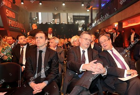 Former German soccer player Philipp Lahm (L), German Football Association (DFB) president Reinhard Grindel (C) and Armin Laschet (R), state premier of North Rhine-Westphalia, attend the opening gala of the 'Hall Of Fame' of German football in Dortmund, Germany, 01 April 2019 (issued 02 April 2019). The Hall Of Fame will be part of the permanent exhibition in the German Football Museum, where players and coaches of men's and women's soccer of German origin will be honoured for their outstanding achievements in shaping German soccer from 1900 until today.