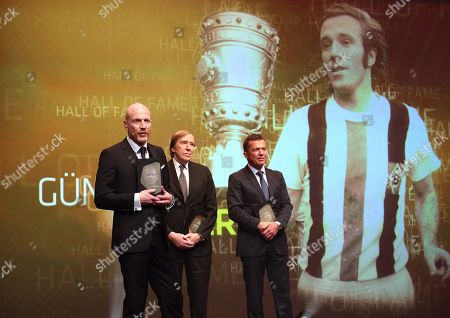 Stock Image of Former German soccer players (L-R) Matthias Sammer, Guenter Netzer, and Lothar Matthaeus are admitted to the 'Hall Of Fame' as the best midfield players during the opening gala of the 'Hall Of Fame' of German football in Dortmund, Germany, 01 April 2019 (issued 02 April 2019). The Hall Of Fame will be part of the permanent exhibition in the German Football Museum, where players and coaches of men's and women's soccer of German origin will be honoured for their outstanding achievements in shaping German soccer from 1900 until today.