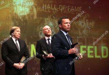 Former German soccer players (L-R) Guenter Netzer, Matthias Sammer, and Lothar Matthaeus are admitted to the 'Hall Of Fame' as the best midfield players during the opening gala of the 'Hall Of Fame' of German football in Dortmund, Germany, 01 April 2019 (issued 02 April 2019). The Hall Of Fame will be part of the permanent exhibition in the German Football Museum, where players and coaches of men's and women's soccer of German origin will be honoured for their outstanding achievements in shaping German soccer from 1900 until today.