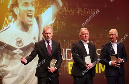 Stock Image of Former German soccer players (L-R) Paul Breitner, Andreas Brehme, and Franz Beckenbauer are admitted to the 'Hall Of Fame' as the best defensive players during the opening gala of the 'Hall Of Fame' of German football in Dortmund, Germany, 01 April 2019 (issued 02 April 2019). The Hall Of Fame will be part of the permanent exhibition in the German Football Museum, where players and coaches of men's and women's soccer of German origin will be honoured for their outstanding achievements in shaping German soccer from 1900 until today.