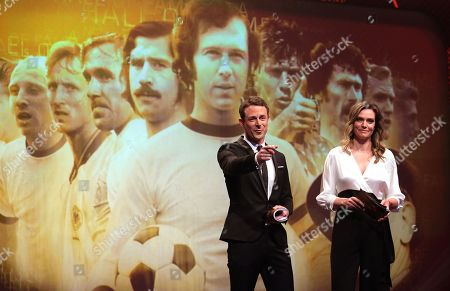Stock Image of German television presenters Alexander Bommes (L) and Julia Scharf (R) moderate the opening gala of the 'Hall Of Fame' of German football in Dortmund, Germany, 01 April 2019 (issued 02 April 2019). The Hall Of Fame will be part of the permanent exhibition in the German Football Museum, where players and coaches of men's and women's soccer of German origin will be honoured for their outstanding achievements in shaping German soccer from 1900 until today.