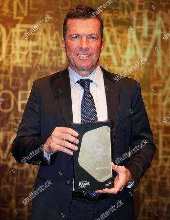Former German soccer player Lothar Matthaeus holds his trophy during the opening gala of the 'Hall Of Fame' of German football in Dortmund, Germany, 01 April 2019 (issued 02 April 2019). The Hall Of Fame will be part of the permanent exhibition in the German Football Museum, where players and coaches of men's and women's soccer of German origin will be honoured for their outstanding achievements in shaping German soccer from 1900 until today.