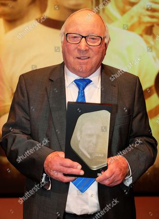 Stock Photo of Former German soccer player Uwe Seeler holds his trophy during the opening gala of the 'Hall Of Fame' of German football in Dortmund, Germany, 01 April 2019 (issued 02 April 2019). The Hall Of Fame will be part of the permanent exhibition in the German Football Museum, where players and coaches of men's and women's soccer of German origin will be honoured for their outstanding achievements in shaping German soccer from 1900 until today.