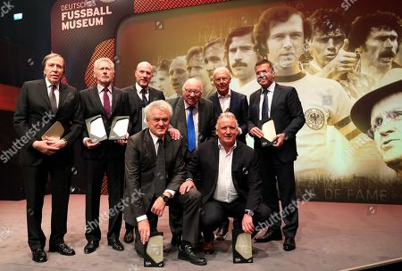 Stock Photo of Former German soccer players (back, L-R) Guenter Netzer, Paul Breitner, Matthias Sammer, Uwe Seeler, Franz Beckenbauer, Lothar Matthaeus; (front, L-R) Sepp Maier and Andreas Brehme pose during the opening gala of the 'Hall Of Fame' of German football in Dortmund, Germany, 01 April 2019 (issued 02 April 2019). The Hall Of Fame will be part of the permanent exhibition in the German Football Museum, where players and coaches of men's and women's soccer of German origin will be honoured for their outstanding achievements in shaping German soccer from 1900 until today.