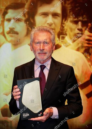 Stock Picture of Former German soccer player Paul Breitner holds his trophy during the opening gala of the 'Hall Of Fame' of German football in Dortmund, Germany, 01 April 2019 (issued 02 April 2019). The Hall Of Fame will be part of the permanent exhibition in the German Football Museum, where players and coaches of men's and women's soccer of German origin will be honoured for their outstanding achievements in shaping German soccer from 1900 until today.