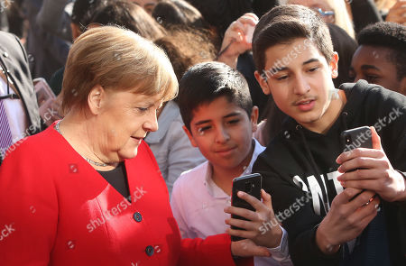 German Chancellor Angela Merkel (CDU) poses with students as she visits the Thomas Mann high school, in Berlin, Germany, 02 April 2019. Merkel visited the school to discuss with youth topics related to the European Union, as part of the EU-Project Day initiative founded by the chancellor herself in 2007.
