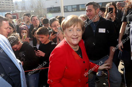 German Chancellor Angela Merkel (CDU) arrives to meet students as she visits the Thomas Mann high school, in Berlin, Germany, 02 April 2019. Merkel visited the school to discuss with youth topics related to the European Union, as part of the EU-Project Day initiative founded by the chancellor herself in 2007.