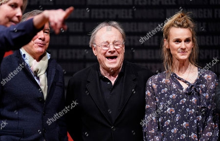 Klaus Maria Brandauer (C), Intendant Nico Hofmann (L) and Director Lilja Rupprecht (R) pose during a press conference at the Nibelungen Festival in Worms, Germany, 02 April 2019. This year's the festival is titled 'Ueberwaeltigung' (lit. overpowering) and will be held on an open-air stage in front of Worms Cathedral from 12 to 28 July 2019.