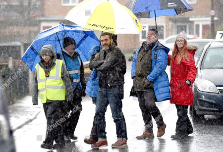 Stock Picture of Coronation Street stars Chris Gascoigne and Richard Hawley film in the rain.
