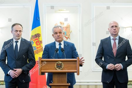 The head of Democratic Party Vladimir Plahotniuc (C) with Andrian Candu (L) former speaker and Pavel Filip (R) former Moldova prime minister, pictured during a press-conference after meeting with the President of Moldova Igor Dodon (not seen), in the State Residence in Chisinau, Moldova, 02 April 2019. The president invited the leaders of Parliament's fractions to discuss about scenarios of exit from political blockage. Four parties had won in Moldova's parliamentary elections on 24 February 2019, but no one get majority, and no government is formed yet on a coalition.
