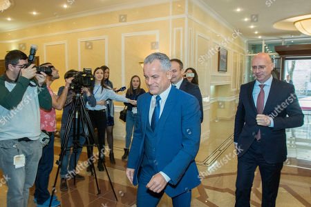 The head of Democratic Party Vladimir Plahotniuc (C) with Pavel Filip (R) former Moldova prime minister, arrived to the meeting with President of Moldova Igor Dodon (not seen) in the State Residence in Chisinau, Moldova, 02 April 2019. The president invited the leaders of Parliament's fractions to discuss about scenarios of exit from political blockage. Four parties had won in Moldova's parliamentary elections on 24 February 2019, but no one get majority, and no government is formed yet on a coalition.