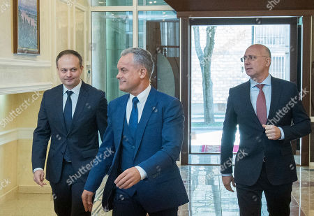 The head of Democratic Party Vladimir Plahotniuc (C) with Andrian Candu (L) former speaker and Pavel Filip (R) former Moldova prime minister, arrived to the meeting with President of Moldova Igor Dodon (not seen) in the State Residence in Chisinau, Moldova, 02 April 2019. The president invited the leaders of Parliament's fractions to discuss about scenarios of exit from political blockage. Four parties had won in Moldova's parliamentary elections on 24 February 2019, but no one get majority, and no government is formed yet on a coalition.
