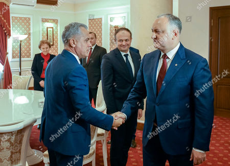 The head of Democratic Party Vladimir (L) Plahotniuc shake hands with the President of Moldova Igor Dodon (R) in the State Residence in Chisinau, Moldova, 02 April 2019. The president invited the leaders of Parliament's fractions to discuss about scenarios of exit from political blockage. Four parties had won in Moldova's parliamentary elections on 24 February 2019, but no one get majority, and no government is formed yet on a coalition.