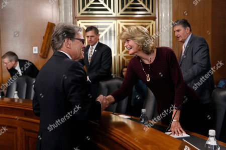 Rick Perry, Lisa Murkowski. Energy Secretary Rick Perry, left, speaks with Sen. Lisa Murkowski, R-Alaska, chairwoman of the Senate Energy and Natural Resources Committee, before testifying before the committee at a hearing on the President's budget request for Fiscal Year 2020, on Capitol Hill in Washington