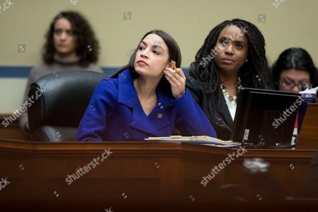 Democratic Representative from New York Alexandria Ocasio-Cortez (L) and Democratic Representative from Massachusetts Ayanna Pressley (R) attend the US House Oversight and Reform Committee markup on a resolution 'Authorizing Issuance of Subpoena Related to Security Clearances; and a resolution Authorizing Issuance of Subpoenas Related to the 2020 Census', on Capitol Hill in Washington, DC, USA, 02 April 2019.   Chairman Elijah Cummings offered a resolution issuing subpoenas to Justice Department officials and Commerce Secretary Wilbur Ross in connection to the 2020 Census. The Chairman also offered a resolution to subpoena former White House Personnel Security Director Carl Kline to testify in connection with the Committee's investigation into the security clearance process at the White House.