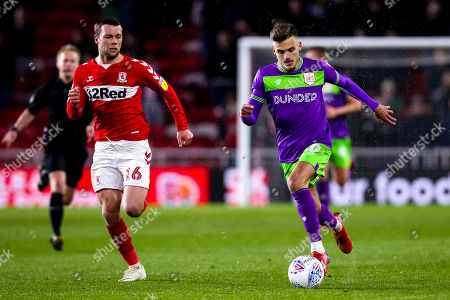Jamie Paterson of Bristol City takes on Jonathan Howson of Middlesbrough