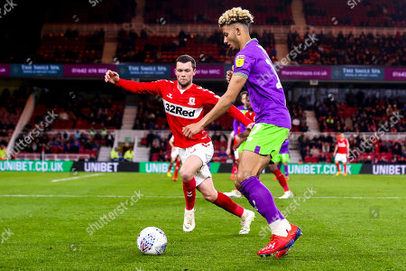 Lloyd Kelly of Bristol City takes on Jonathan Howson of Middlesbrough