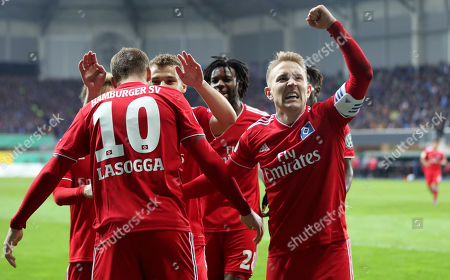 Hamburg's Lewis Holtby (R) celebrates the second goal with his team during the German DFB Cup quarter final soccer match between SC Paderborn and Hamburger SV in Paderborn, Germany, 02 April 2019.
